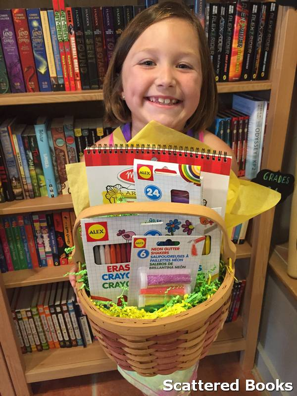Little girl happy with her new book basket from Scattered Books